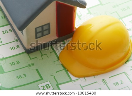 house and helmet on  the draft - stock photo