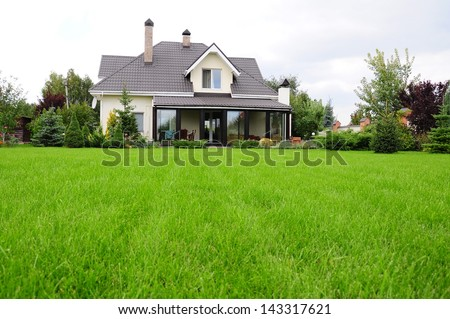 house and its garden - stock photo