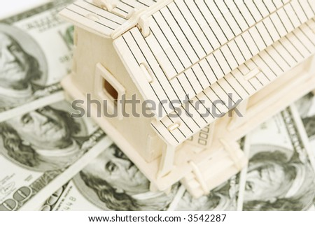 house and money (special toned photo f/x, focus point on the roof) - stock photo