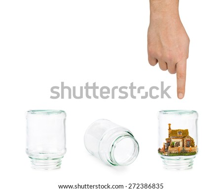 House and shell game with glass jars isolated on white background - stock photo