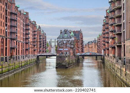 House and two brides in old warehouse district (Speicherstadt), Hamburg, Germany - stock photo