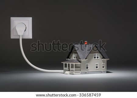 House architectural model connected to electricity - stock photo