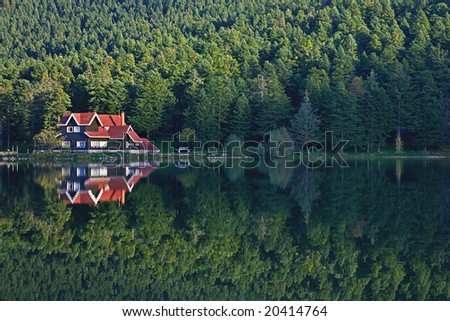 house at the forest lake with reflection Golcuk, Bolu, Turkey - stock photo