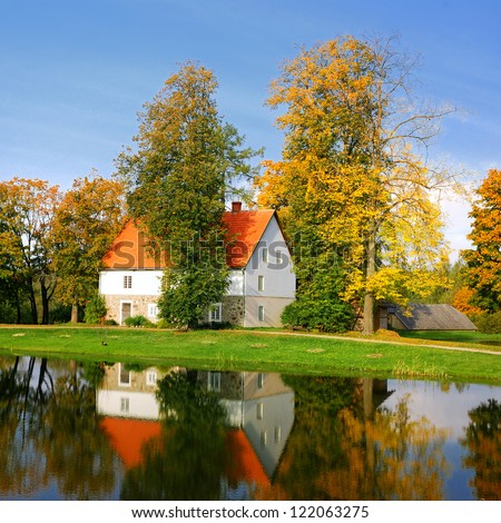 house at the lake bank in autumn. Sigulda, Latvia - stock photo
