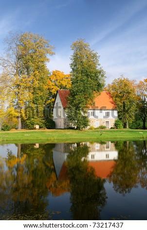 house at the lake bank in autumn. Sigulda, Latvia - stock photo
