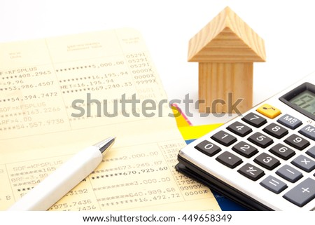 house, Bank book, a calculator, a pen, The concept of financial planing to buy a home. Financial tools