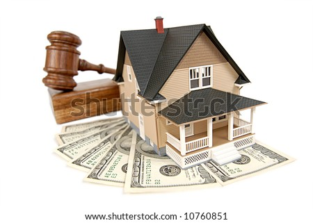 House being sold at an auction; isolated on white - stock photo