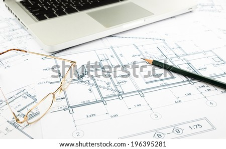 house blueprints and floor plan with keyboard, architecture business concepts and ideas