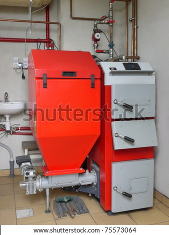 House boiler room with coal-fired central heating furnace system - stock photo