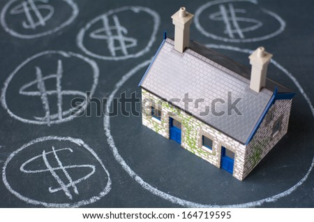 House bubble boom presentation on chalkboard. Concept photo of Real estate market bubble , booming, money,price, rent, grid, home, house, housing, industry and subprime mortgage crisis. (Copy Space) - stock photo