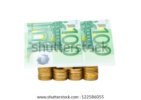 house built of coins and euro banknotes isolated on white background