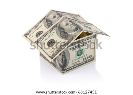 House built with Dollar money bills isolated on white background with clipping path - stock photo
