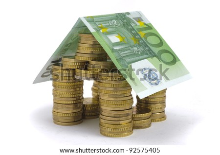 house built with euro coins and banknote - stock photo