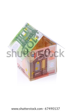 House built with Euro money bills isolated on white background with clipping path - stock photo