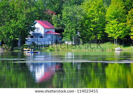 House by the lake in Quebec, Canada - stock photo