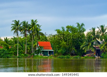 house by the river - stock photo