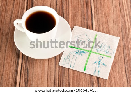 House, car, plant and human on a napkin and cup of coffee - stock photo