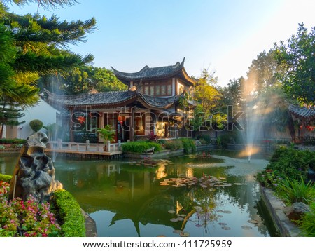 House Chinese tradition in green garden with pond lake.