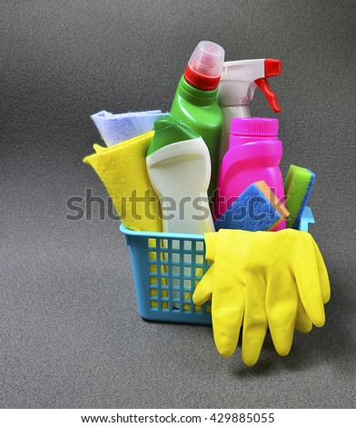 House cleaning product in blue basket.Cleaning equipment.Cleaning concept with supplies. - stock photo