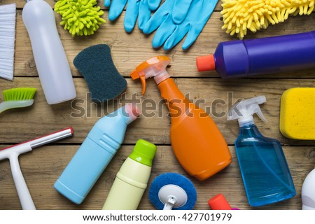 House cleaning product on wood table - stock photo