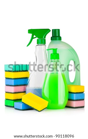 House cleaning product. Plastic bottles with detergent and sponge isolated on white background - stock photo