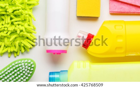 House cleaning products on white table - stock photo
