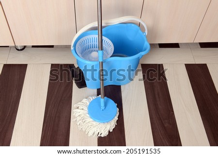 House cleaning with  mop - stock photo