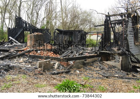 house completely burned to the ground and destroyed by fire - stock photo