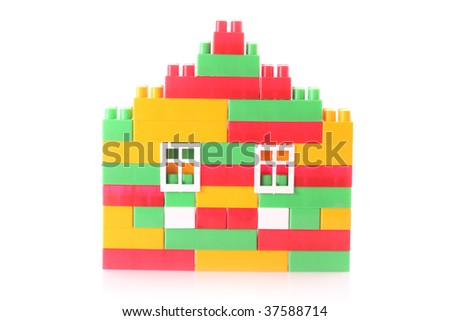 House constructed from toy bricks isolated on white