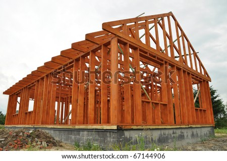 House construction in the framing stage - stock photo