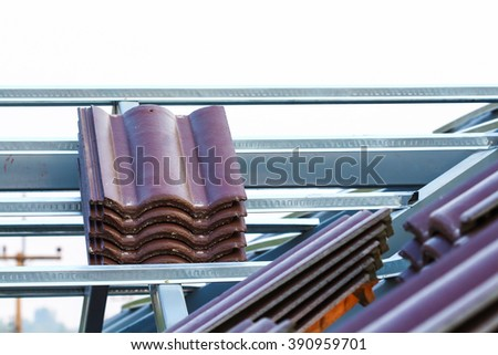 House construction. Roofing tiles preparing - stock photo