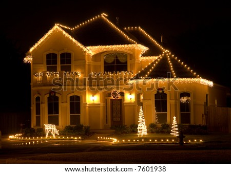 House Decorated and Lighted for Christmas at Night - stock photo