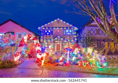 House Decorated and Lighted for Christmas at Night at Vancouver, Canada. - stock photo