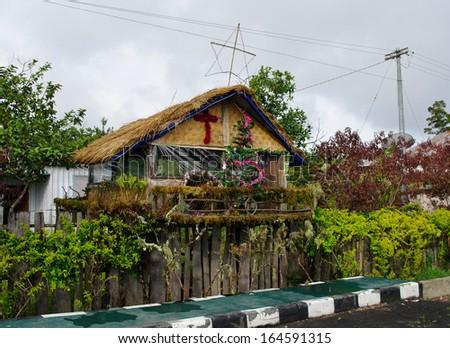 House decorated before Christmas, Papua Province, New Guinea island - stock photo