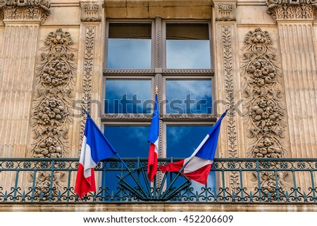 House decorated with the flags of France, on the French National Day (Bastille Day). Paris. - stock photo
