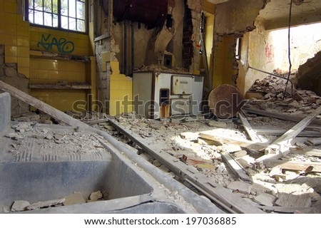 house destroyed by an explosion full of debris - stock photo