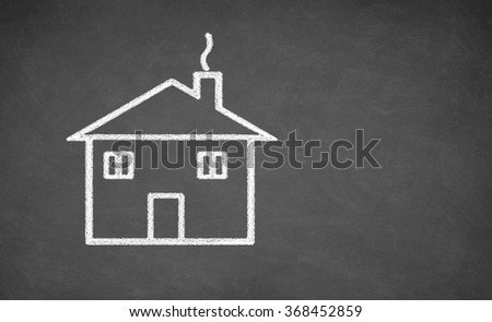 House drawing on chalkboard. White chalk and balckboard