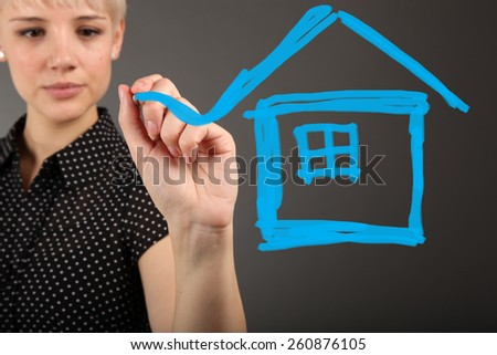 House dreaming concept with business woman - stock photo