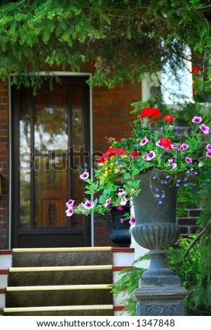 House entrance with flower vase - stock photo