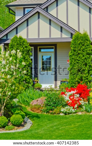 House entrance with nicely landscaped front yard. - stock photo