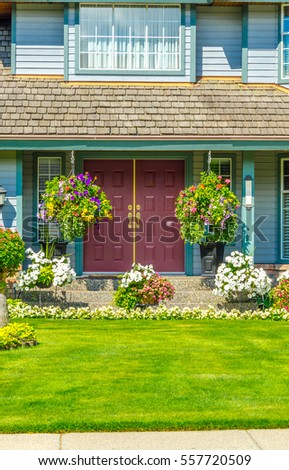 House entrance with nicely landscaped front yard.