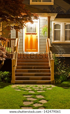 House entrance with nicely paved doorway  at night, dawn time. - stock photo