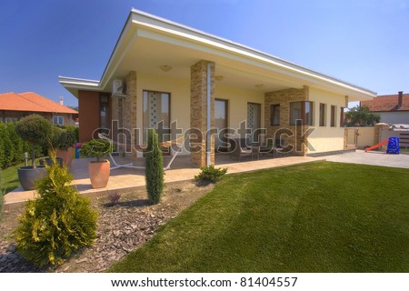 House exterior with landscaped garden.
