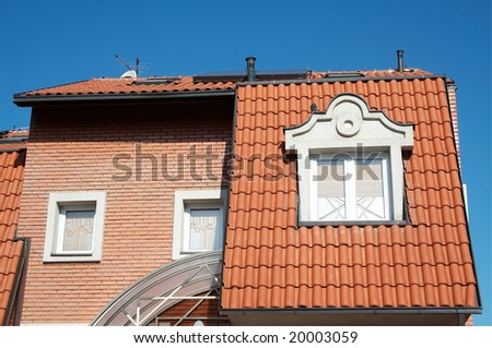 House facade on blue sky - stock photo