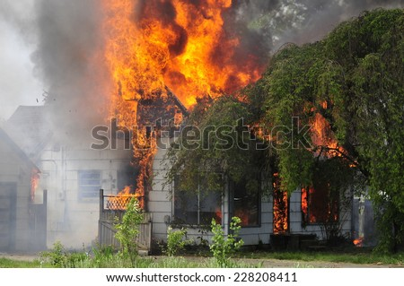 House fire fire fighter training - stock photo