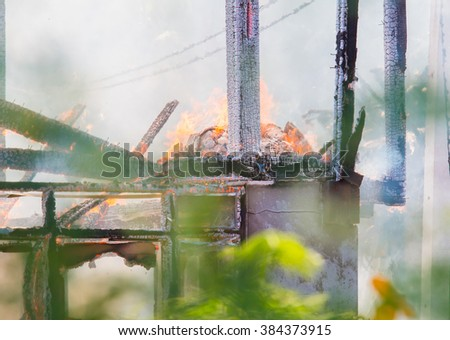 House fire in Daytime. - stock photo