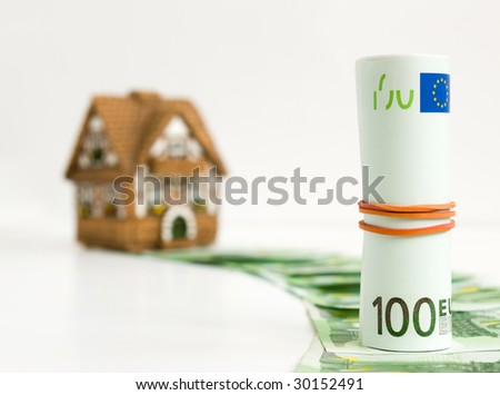 House for hundred euros (selective focus) - stock photo