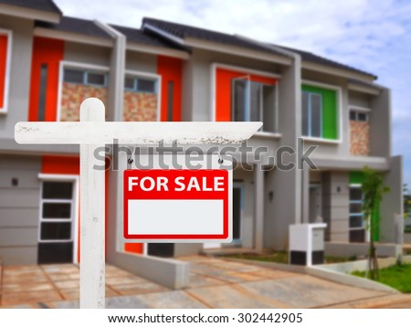 House for sale board with house background. You can put your number on the board - stock photo