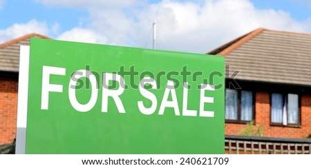 House for sale green sign - stock photo