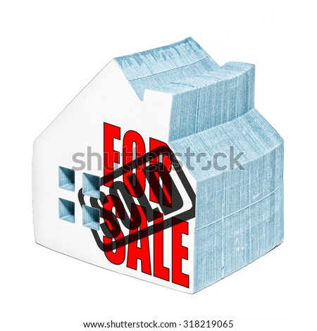 House for sale is sold concept made from a house shaped post it notepad. - stock photo